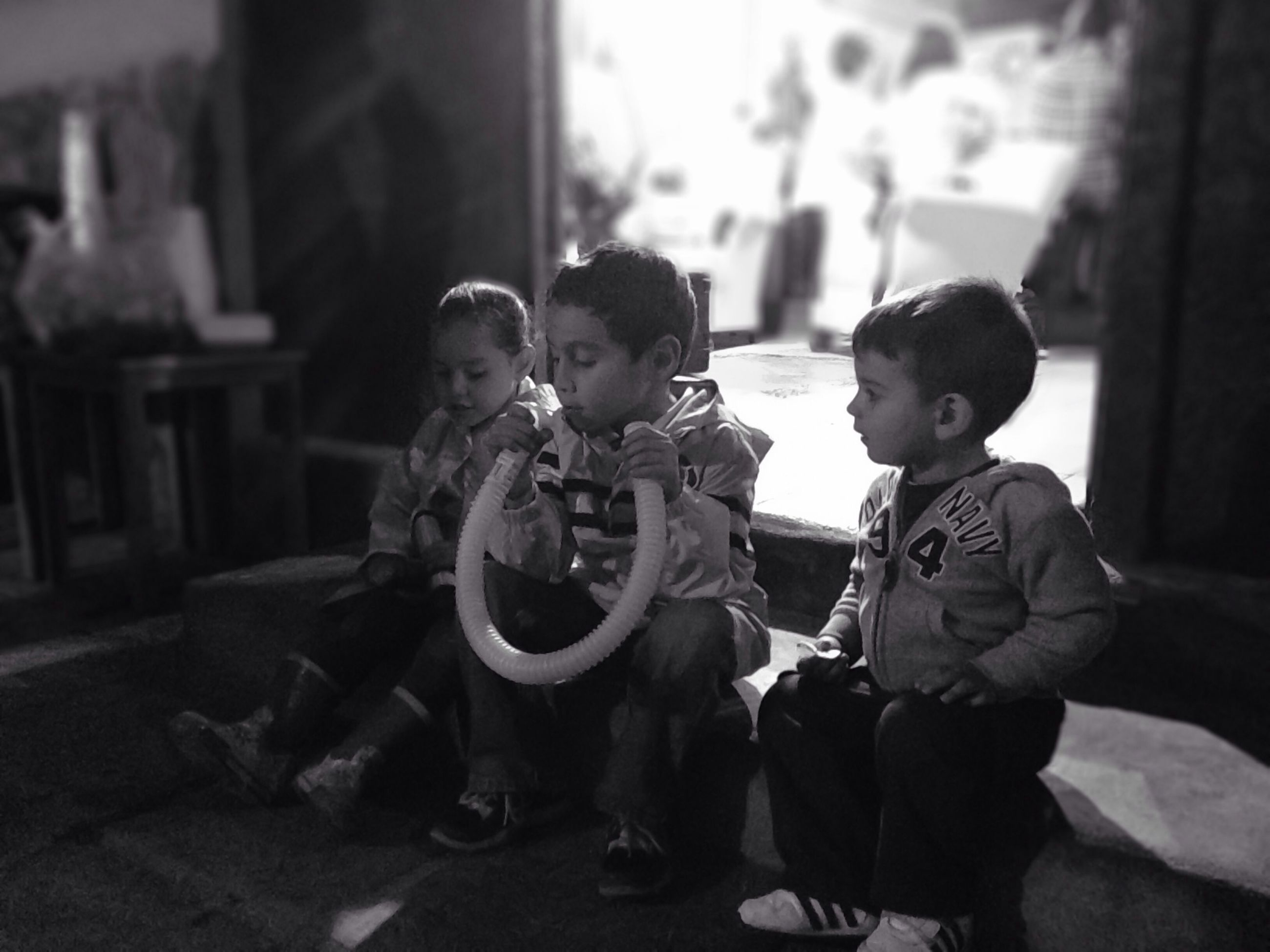 childhood, boys, lifestyles, elementary age, leisure activity, casual clothing, indoors, person, sitting, innocence, togetherness, focus on foreground, bonding, full length, cute, men, girls