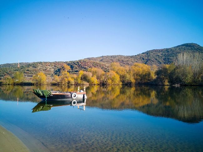 Boat at the river Sabor, Portugal. River Sabor Portugal EyeEm Selects Reflection Lake Water Outdoors Nature Tranquility Nautical Vessel Clear Sky No People Beauty In Nature First Eyeem Photo