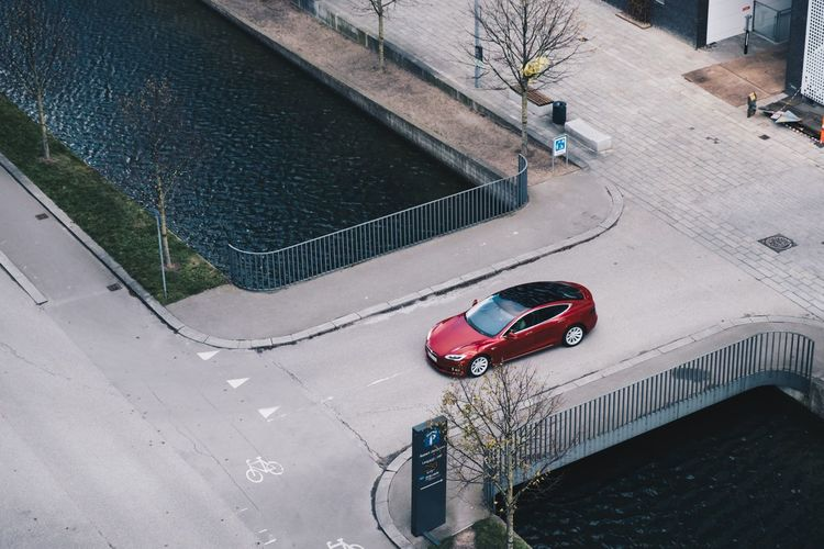 Water Tesla Red Car Car High Angle View Transportation Land Vehicle Mode Of Transport Day Street Road Red City No People