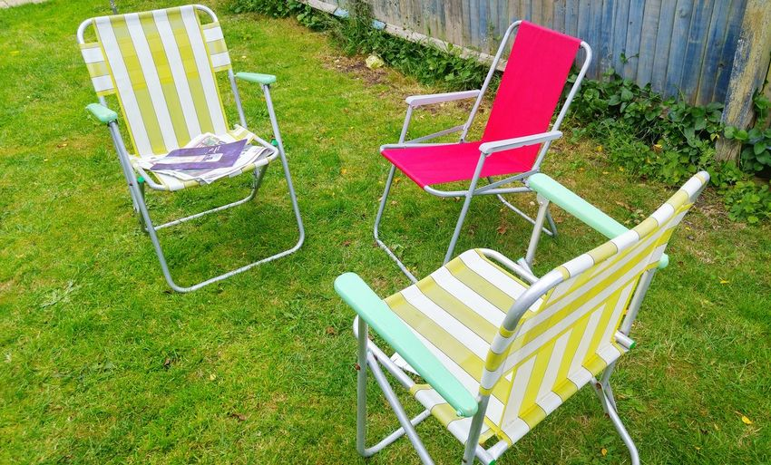 Empty deck chairs in back yard