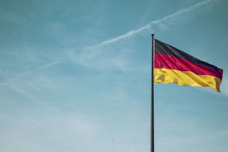 Low Angle View Of German Flag Against Sky