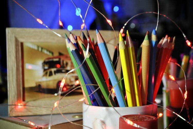 Close-up of illuminated lighting equipment on table