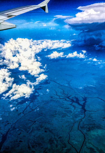Flying high Jet Engine Air Vehicle Aircraft Wing Airplane Beauty In Nature Blue Cloud - Sky Flying Mode Of Transportation Scenics - Nature Sky Transportation Travel Wing Tip