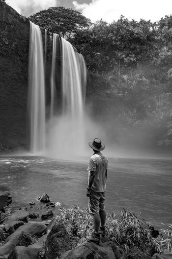 Rear View Of Man Standing By Wailua Falls