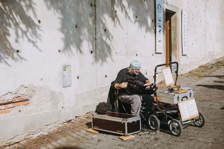 Castle Czech Republic Prague Canon Day Daylight Europe Lifestyles Men Musical Instrument Oldman One Person Outdoors Real People Shadow Sitting Streetartist Streetphotography