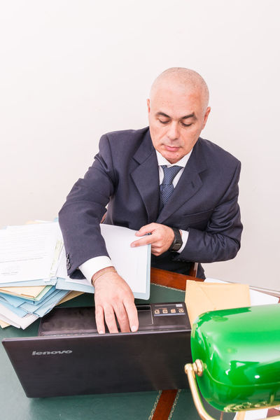 Bald Bald Head Baldeneysee Baldhead Balding Baldness Business Businessman Corporate Business Day Desk Indoors  Mature Adult Mature Men Men Occupation Office One Person People Real People Sitting Suit Well-dressed White Background