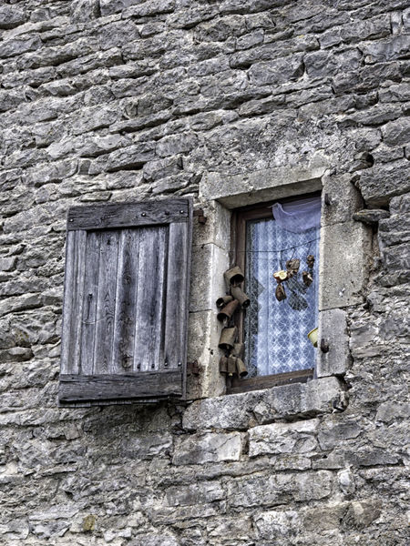 Architecture Bells Building Exterior Built Structure Cow Bells Day House Low Angle View No People Shutter Stone Stone Material Window