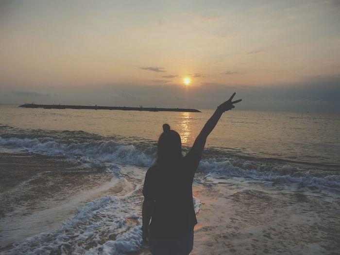 Sun rise alone Sealife Seaphoto Sea View EyeEm Gallery Eyeemview EyeEm Selects EyeEm Sea Life Eyeem Market Sea And Sky Seascape Sunrise Sunrise Day Sunrise/Sunset Fighting Alone Alonetime Alone Sea Water Swimming Sea Sunset Beach Wave Pets Sand Sunlight Horizon