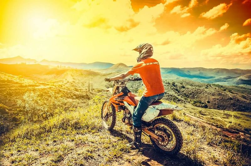 Motocross Moto rilha Riding One Person Headwear Transportation Bicycle People Adventure Cycling Adults Only Sports Helmet Side View Motorcycle Outdoors Only Women Adult Day Full Length Helmet One Woman Only Mountain Bike
