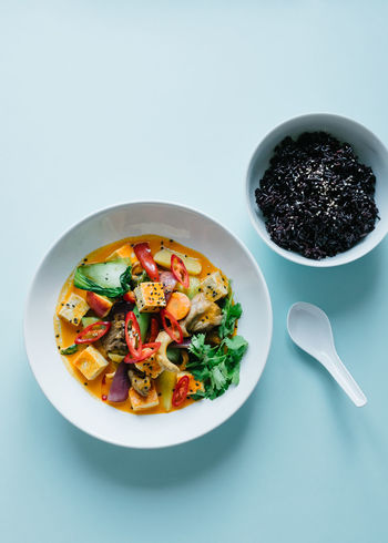 Red thai curry with pak choi, oyster mushroom, peach and tofu. Abundance Blue Bowl Close-up Curry Directly Above Food Freshness Healthy Healthy Eating Indulgence Meal No People Organic Overhead View Plantbased Plate Ready-to-eat Served Serving Size Still Life Studio Shot Thai Vegan Vegetarian