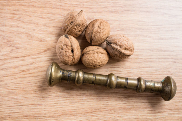 nuts and iron bar Close-up Cork - Stopper Gavel Indoors  No People Studio Shot Wine Cork Wood - Material