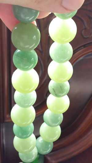 Translucent Beads under the daylight Green Color Jade Green Serpentine Agate Stone Gelatin Dessert Candy Dessert Multi Colored Close-up Sweet Food Food And Drink Display Arrangement
