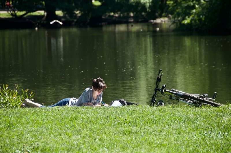 Water One Person Girl Bicycle Lake Grass Green Color Hollyday Streetphotography Street Photography Water Lake Lying Down Side View Grass Sky The Street Photographer - 2019 EyeEm Awards