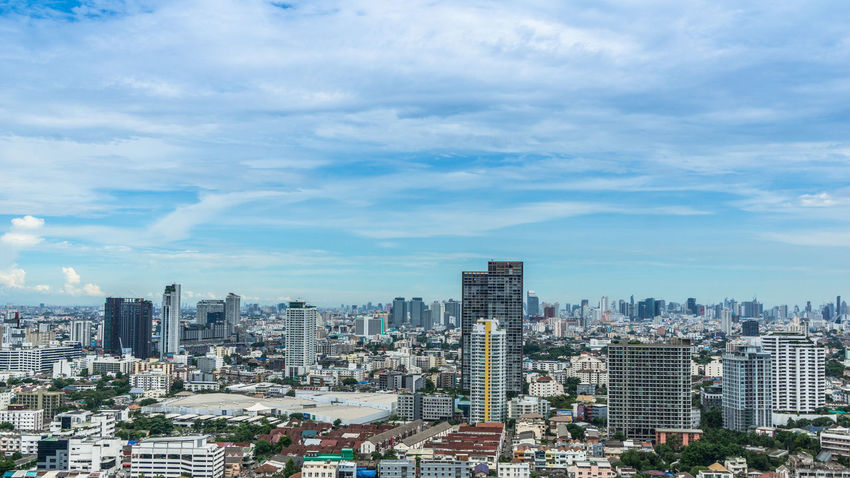 Ariel view of Buildings in Bangkok Architecture City Cityscape Horizontal Panorama Panoramic Residential  Scenic Skyline TOWNSCAPE Thailand Towers And Sky Above The City Aerial View Bankgkok Building Capital City High Angle Horizon Landscape Metropolitan Office Building Scene Skyscraper Town
