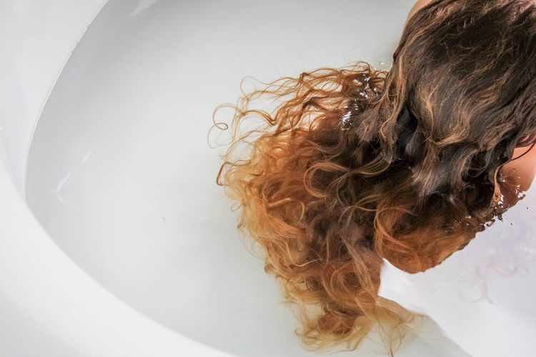 Woman with hair in water