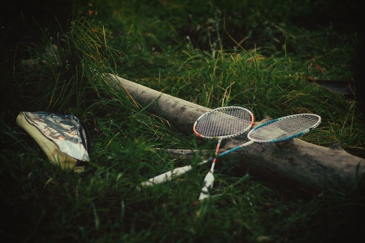 View of tennis racquets on grass