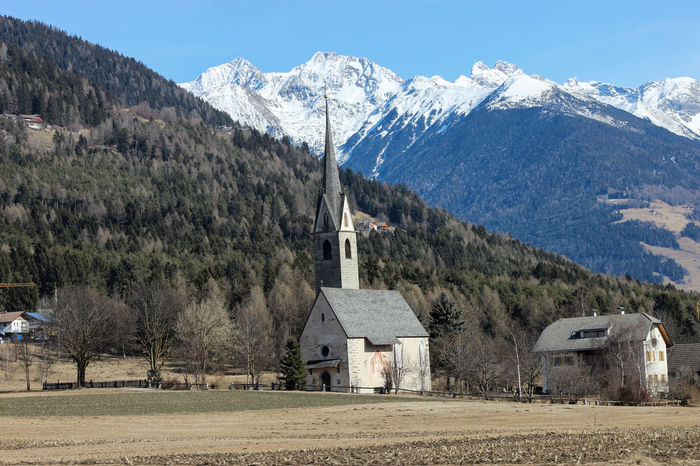 Driving around the Dolomites area. Architecture Building Exterior Built Structure Church Day Eye4photography  EyeEm Best Shots EyeEm Nature Lover Hill Italy Landscape Mountain Mountain Peak Mountain Range Nature No People Outdoors Pine Tree Pine Wood Place Of Worship Relaxing Scenics Sky Snow Village