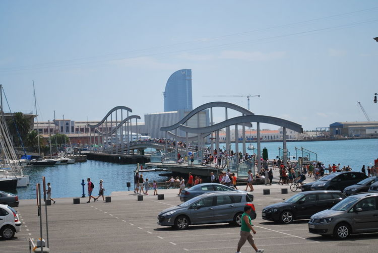 Adult Adults Only Architecture Barcelona Barcelona, Spain Bridge - Man Made Structure Car Catalonia Catalunya City Clock Cloud - Sky Crowd Day Large Group Of People Nautical Vessel Only Men Outdoors People Sky SPAIN Traffic Transportation Travel Destinations Water