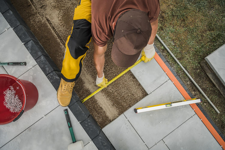 High angle view of man working on floor