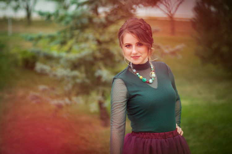 Artistic and natural portrait of beautiful woman in the nature. Woman Face Portrait Beautiful Beauty Smile Female Girl Young Hair Natural Nature Outdoors Skin White Happy Attractive Background Lifestyle Fashion Cute Skirt Green Purple Blouse One Person Looking At Camera Dress Clothing Focus On Foreground Smiling Standing Waist Up Beautiful Woman Front View Women Young Adult Brown Hair Emotion Hairstyle Pearl Jewelry