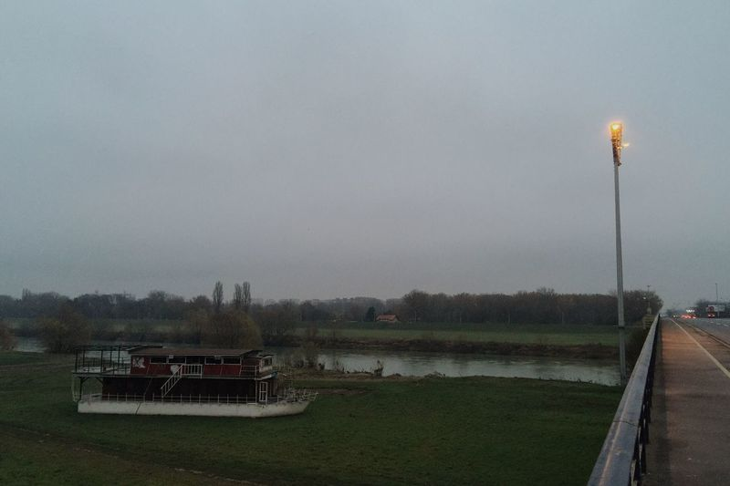 One of typical grey and gloomy winter days in Zagreb, Sava river bank near Liberty Bridge, Croatia, Nov 27, 2016. Grey Sky Gloomy Gloomy Day Zagreb Croatia Sava River Liberty Bridge Bridge River River Bank  Transportation Beauty In Nature Scenics Outdoors Foggy City Lights