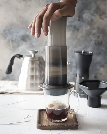Coffee - Food and Drink Photo Collections Body Part Coffee Coffee - Drink Coffee Pot Cup Drink Finger Food And Drink Glass Hand Holding Human Body Part Human Hand Indoors  Lifestyles Mug One Person Pouring Preparation  Real People Refreshment Table
