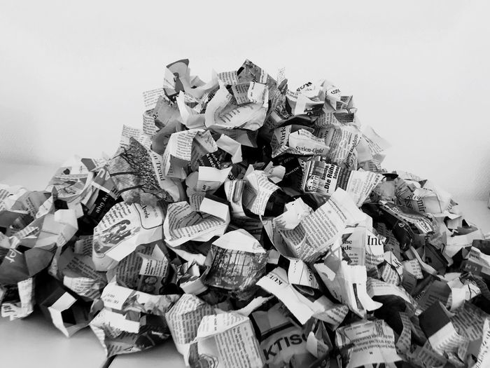 Close-Up Of Crumpled Newspapers On Table