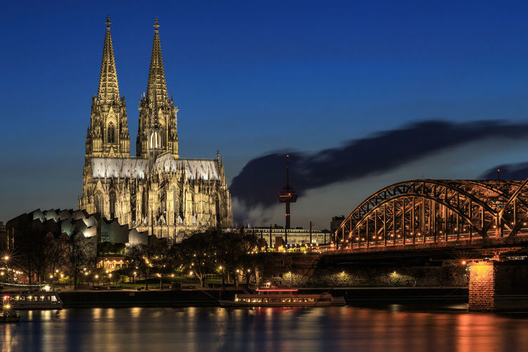Blue hour over Cologne with the Dom and the Hohenzollern bridge Blue Hour Cathedral Cloud Cologne Cologne, Germany Köln Kölner Dom Nightphotography Architecture Bridge Bridge - Man Made Structure Building Exterior Built Structure Hohenzollernbridge Hohenzollernbrücke Illuminated Night No People Outdoors Place Of Worship River Sky Travel Destinations Water Waterfront