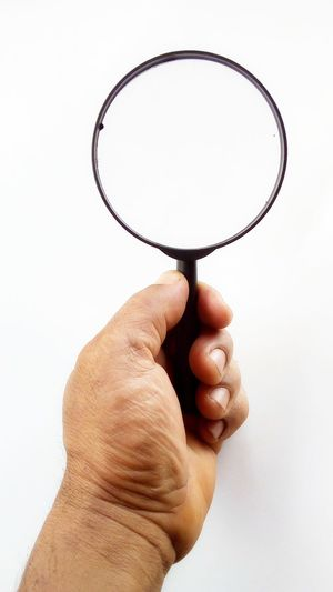Magnifying Glass Magnifier Zoom Human Hand Hand Human Body Part White Background One Person Indoors  Body Part Human Finger Finger Close-up Transparent Unrecognizable Person Geometric Shape Studio Shot Glass - Material Glass Icon Concept Model Plastic Abstract Backgrounds Backdrop EyeEm Best Shots Design Catching A Show Handle