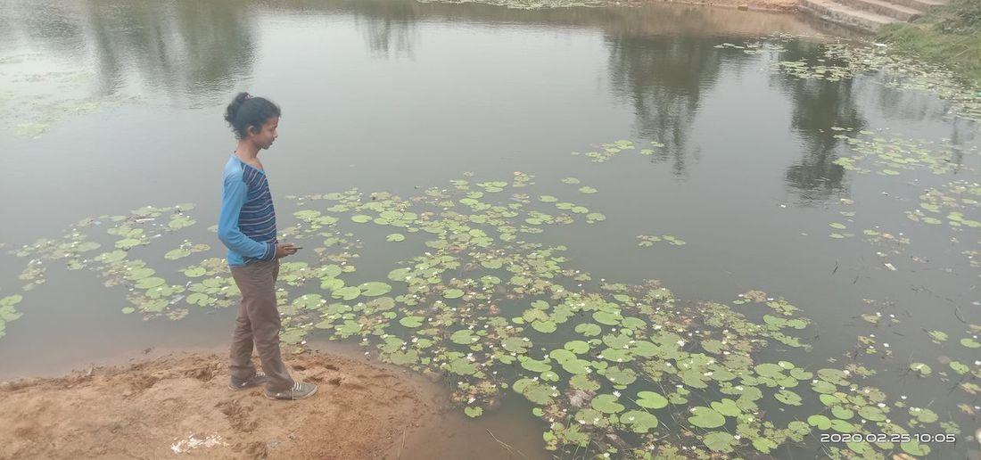 Man standing by lake