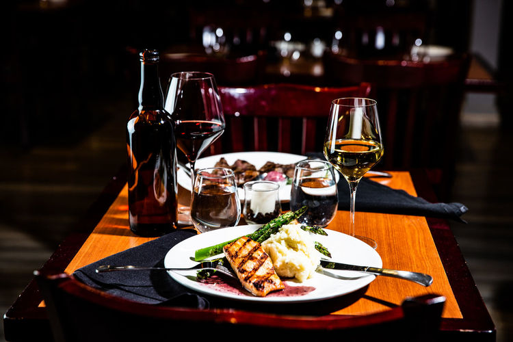 Food And Drink Table Alcohol Drink Glass Refreshment Wine Plate Food Wineglass Freshness Red Wine Indoors  Ready-to-eat Restaurant No People Business Drinking Glass Focus On Foreground Household Equipment Meal Dinner Setting