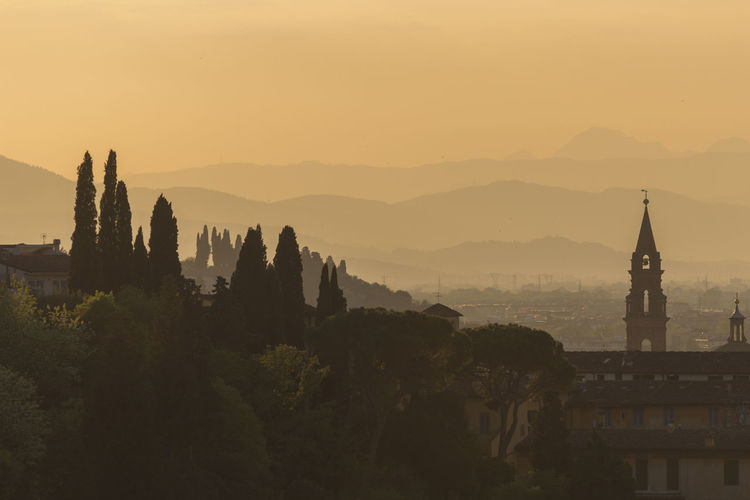 Firenze Sunset_collection Architecture Beauty In Nature Belief Building Building Exterior Built Structure Mountain Mountain Range Nature No People Orange Color Outdoors Place Of Worship Plant Religion Scenics - Nature Sky Spire  Spirituality Sunset Travel Destinations Tree First Eyeem Photo HUAWEI Photo Award: After Dark