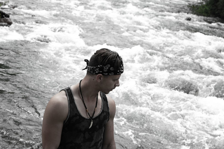 High angle view of man looking away while standing by river