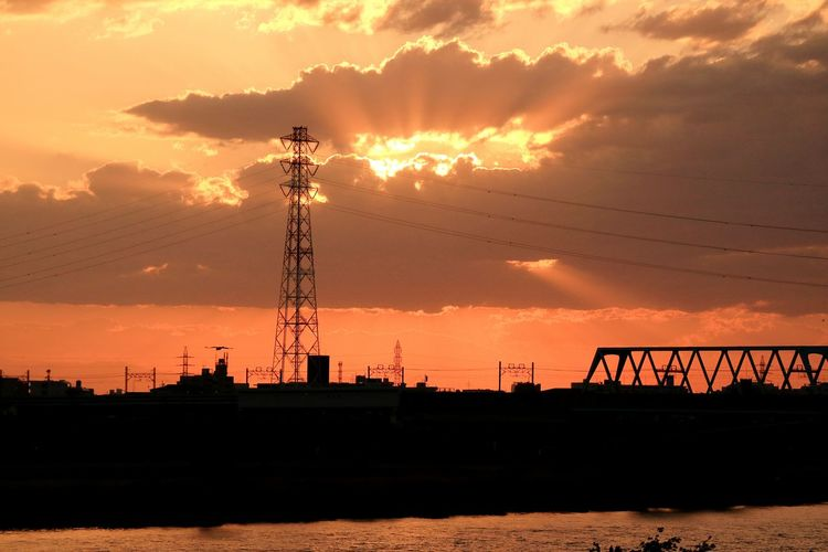 Electricity Pylon Against Scenic Sky