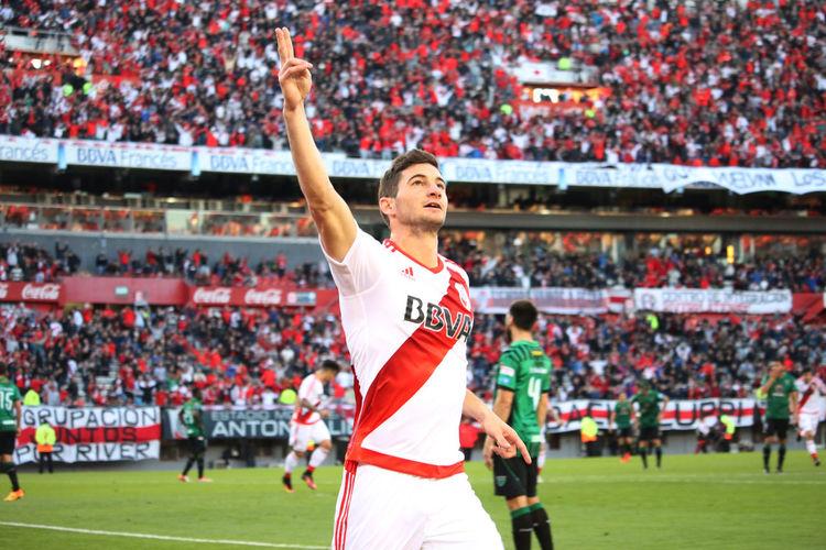 Soccer player gesturing at stadium