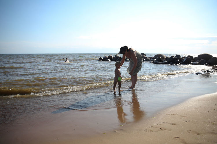 Mother and daughter playing on the beach in summer Adult Baltic Sea Beach Beachphotography Beauty In Nature Clear Sky Day Family Horizon Over Water Mother And Daughter Nature Occupation One Person Outdoors People Playing Sea Sky Sport Water Women
