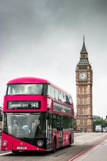 Typical view of London Double-decker Bus Mode Of Transportation Architecture Transportation Bus City Clock Tower Built Structure Building Exterior Public Transportation Tower Motion Traffic Travel Travel Destinations Building Land Vehicle Sky Government Outdoors Clock London Big Ben England Cloudy