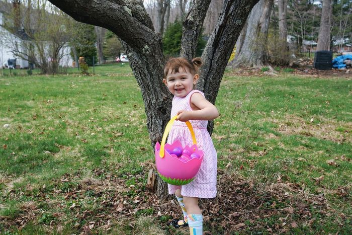 found an egg. Easter Sunday Child Easter Eggs Easter Egg Kids Being Kids Happiness Youth Backyard Fun Leisure Activity Outdoors Fun Childhood Grass One Person Playing Lawn Tree Cute Happiness Smiling Portrait Nature
