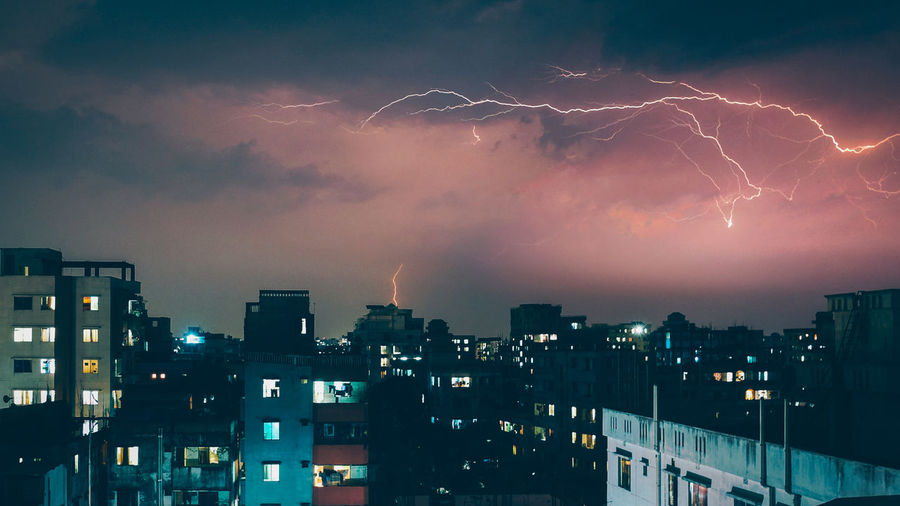 The windows of my room are the best places to watch a Thunderstorm Bangladesh Architecture Beauty In Nature Building Building Exterior City Cityscape Cloud - Sky Illuminated Lightning Nature Night No People Outdoors Power Power In Nature Rhsumon Sky Storm Thunderstorm