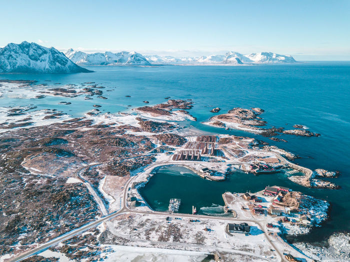 Laukvik, small fishing village - Lofoten Island Water Sea Scenics - Nature Nature Sky Land Environment Day Mountain Beauty In Nature Tranquil Scene Tranquility No People Landscape Blue Cold Temperature Aerial View Travel Destinations Beach Outdoors Ice Horizon Over Water Laukvik Lofoten Norway 2018 In One Photograph