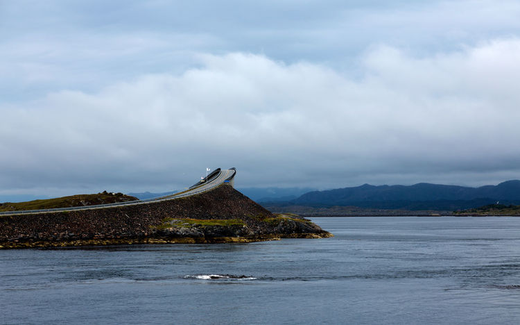 Landscape of Norway, Atlantic Ocean Road. Atlantic Road Eide Norway Travel Atlantic Ocean Road Beauty In Nature Cloud - Sky Day Land Mountain Mountain Range Nature No People Non-urban Scene Norway Nature Outdoors Overcast Scenics - Nature Sea Sky Tranquil Scene Tranquility Transportation Travel Destinations Water