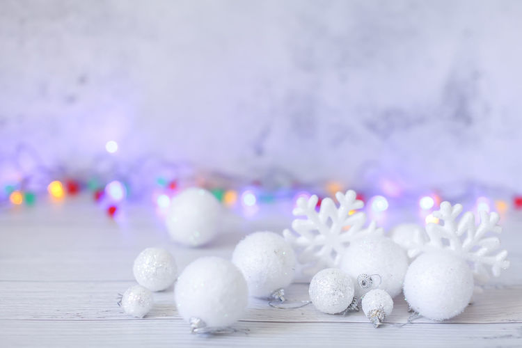 Close-up of white decorations on table