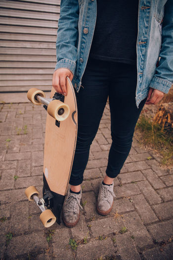 Young woman with skateboard and jeans jacket Cool EyeEm Selects EyeEm Gallery EyeEmNewHere Fun Party Time Casual Clothing Day Holding Human Body Part Jeans Leisure Activity Lifestyles Men One Person Outdoors Party Real People Shoe Skate Skateboard Standing Women Young Women