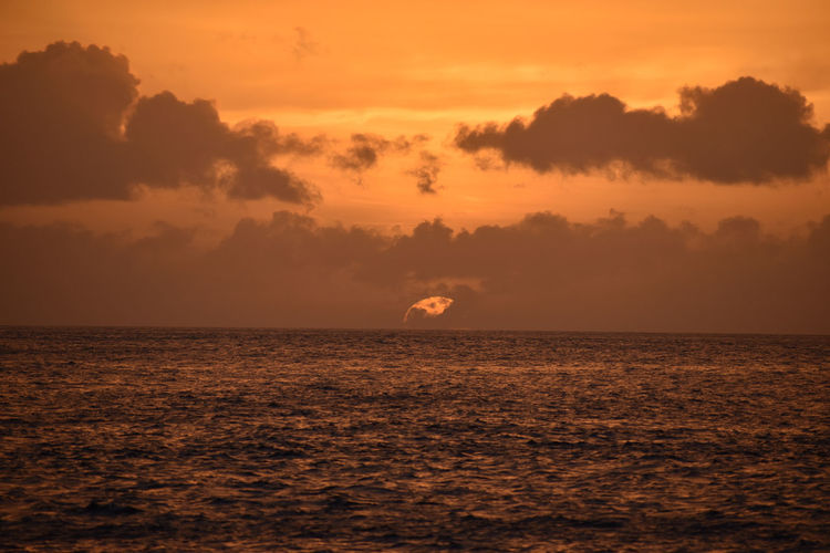 Scenic view of sea against orange sky saint lucia