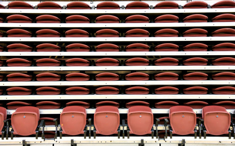 Volleyball and basketball seats Seattle Bleachers Fan Seats Lined Up Lined Up In A Row Many Organized Seat Sports Seats Stacked Stacked Seat Stadium Seats Symmetrical Volleyball Seats