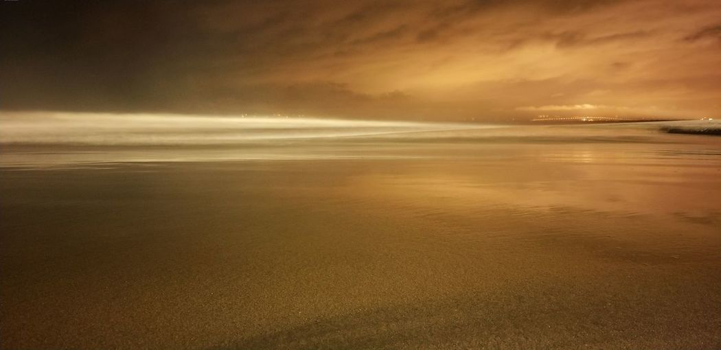 wb change Neon Long Exposure No People Beauty In Nature Nature Nofilter Ocean Water Sea Beach Sunset Low Tide Sand Wave Reflection Dramatic Sky Sky Seascape Atmospheric Mood Sky Only Standing Water Meteorology Calm Cloudscape Stratosphere