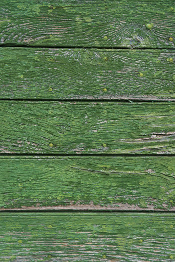 Backgrounds Close-up Cracked Damaged Day Green Color Nature No People Outdoors Pattern Rough Striped Textured  Timber Weathered Wood - Material Wood Grain Wood Paneling