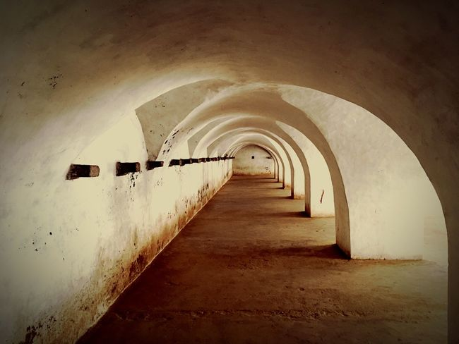 Colonel Bailey's Dungeon..!! Dark history..! Venerable Dark History Dungeon EyeEm Selects Arch Indoors  The Way Forward Corridor Architecture Built Structure Prison No People Day