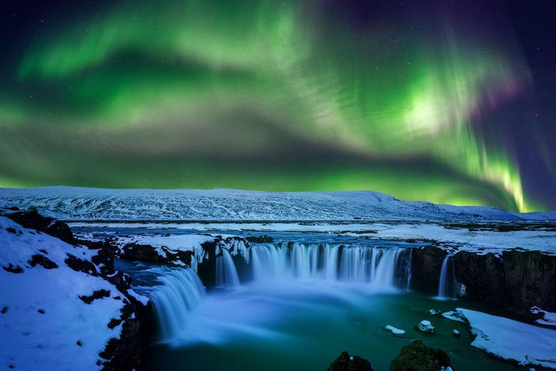 Aurora borealis over godafoss falls at night