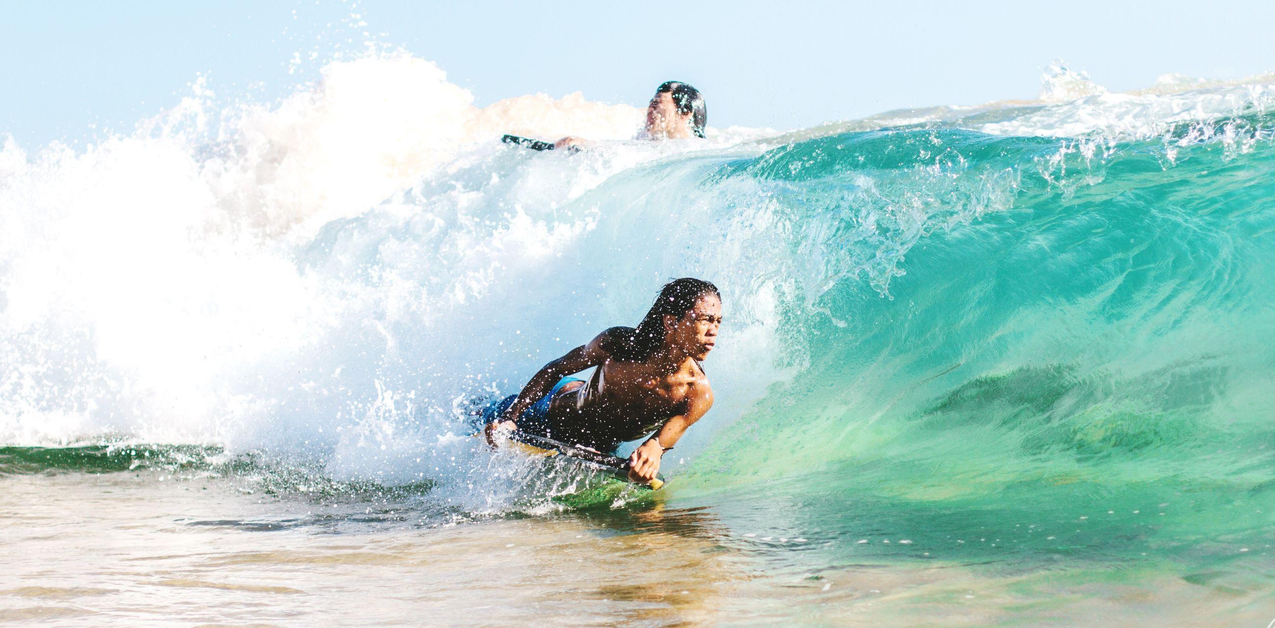 water, leisure activity, lifestyles, sea, men, enjoyment, motion, vacations, waterfront, fun, splashing, sport, wave, full length, extreme sports, adventure, skill, sky